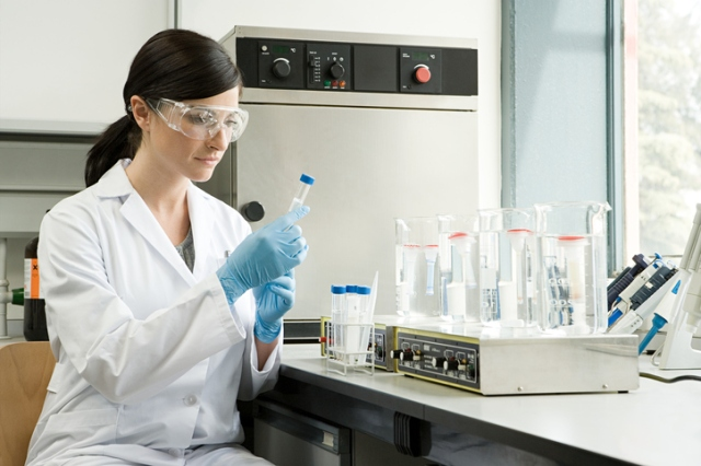 A scientist inspecting a test tube