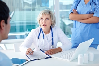 Female doctor surprised at diagnosis of her patient