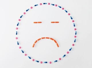 A sad face is made in pills.